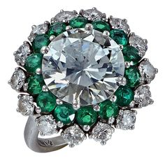 Emerald Diamond Platinum Ring | From a unique collection of vintage more rings at https://www.1stdibs.com/jewelry/rings/more-rings/