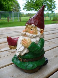 When Gnomie sat very still and quiet, some times birds would rest on his hands. Actually, they suspected hidden bird seeds in his pocket. How can we find the hidden seeds, the birds wondered?