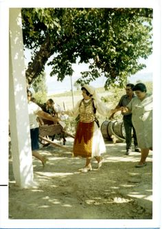 My mom, dancing in Livantes, This was her father's village, and the relatives dressed Mom up in the local traditional outfit. Folk Costume, Costumes, Mom Dress, Greeks, Traditional Outfits, The Locals, My Mom, Dancing, Sequins