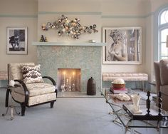 Gorgeous cool-toned fireplace surround. The mercury glass candle sticks in the fire box are simple elegance.