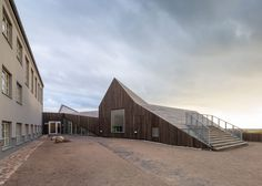 dorte mandrup arkitekter, Kopenhagen, Kindertagesstätte, Schweden, Fassade, Holz, Dachlandschaft, Natur, Außenansicht