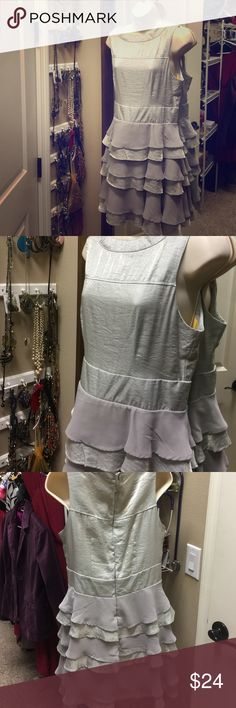 NWOT flirty and fun dress  L, fits like a 7/8 So cute! Brand new from Tulle. Sized large but fits like a 7/8. Layers of shimmery silver and gray. Very figure flattering. Lined with yellow silk. Extra button included. Shell:  % polyester. Dry clean only. Zip up back perfect dress for dancing  Tulle Dresses