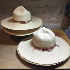 Ranger hats in natural Panama straw with a red leather fancy...
