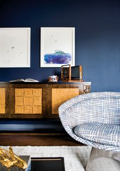 Love the deep blue for a living room accent wall