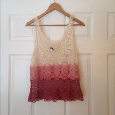 American Eagle Pink Ombré Lace Tank 100% Cotton, worn and washed only a few times. As you can see the pink color got on the white lace when I washed it the first time, but it's nothing too dramatic, just a couple specs. But I had people come up to me and think that was part of the shirt! Really nice shirt in really good condition. American Eagle Outfitters Tops Tank Tops