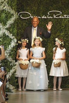 Designer Oscar de la Renta and his cute little attendants.