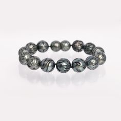 Just breathtaking! Queen III Tahitian Pearl bracelet from Galatea: Jewelry by Artist. Each of the unique carving styles is completed by hand and polished to reveal the unique beauty of each pearl. Style CBB810.