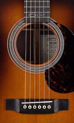 Martin guitar - 000-28M Eric Clapton Sunburst signature model......yeah, I got to PLAY one of these today........the most beautiful, even tone I have EVER heard. GORGEOUS!