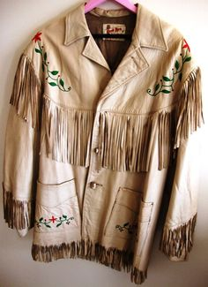 """A Western jacket is a coat that was used mainly for horse back riders and as a western fashion statement. They usually are made out of leather and have tassels hanging down.  """"Etsy."""" Etsy. Western Jacket N.p., n.d. Web. 27 Mar. 2013"""