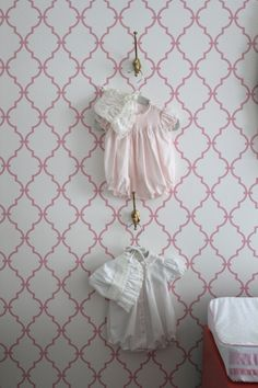 Love, love the idea of hanging special, keepsake or vintage clothing in the nursery!