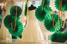 Beautiful Emerald backdrop for our SPARKLE gowns! Window decor by Kate Miller Events, Photo by Sarah Maren Photographers