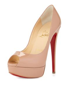 """Christian Louboutin patent leather pump. 6"""" covered heel; 2"""" platform; 4"""" equiv. Peep toe. Low-dipped vamp. Topstitched collar. Leather lining and footbed. Signature red leather sole. """"Lady Peep"""" is m"""