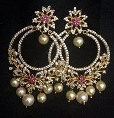 Grand 2 layer circle chand balis with pearl drops Code : ERJ 426 Rps. 1250/- size. 2.2 inch long Whats app to 09581193795 for order processing