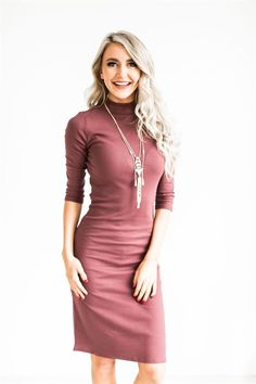 """This Mock Neck Midi Dress is a closet staple this season! Made of ultra-soft ribbed fabric with 3/4""""; sleeves, and mock neck cut, the layering options with this dress are endless!"""