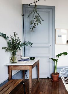 Beautiful room, love the blue door against the green of the indoor plants.