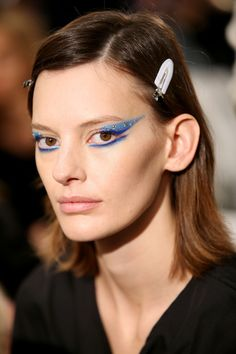 At Prada, Pat McGrath created graphic, extended eyes in bold-coloured shadow for several of the models, whilst others wore bare-faced natural looks.