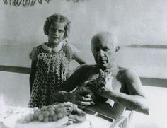Pablo Picasso, his daughter Paloma and his cat