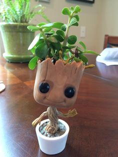 My take on a growing baby groot. Even better than the chia pet version. My take on a growing baby gr Chia Pet, Baby Groot, Succulent Pots, Succulents Garden, Garden Planters, Planter Pots, Clay Crafts, Diy And Crafts, 3d Puzzel