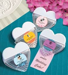 Personalized Heart Shaped Magnetic Wedding Memo Clips (FashionCraft 6749ST)   Buy at Wedding Favors Unlimited (https://www.weddingfavorsunlimited.com/personalized_heart_shaped_magnetic_memo_clips.html).