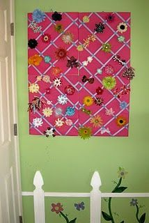 I used 4 photo ribbon boards to organize hair clips.  They are just placed on the wall to make it look like one large unit.