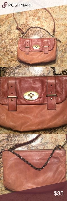 Nice FOSSIL bag Two toned tan leather has removable shoulder strap. Has chain. Inside roomy with many pockets. Has outside pocket with flap. Zipper and all closures fine. Lining pretty without flaws. Fossil Bags Crossbody Bags