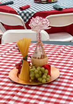 These were the centerpieces we used for an Italian Theme Event. We used real grapes, a chianti bottle, dry pasta and a candle on a charger. And the flower in the chianti bottle was made out of a coffee filter. HSO