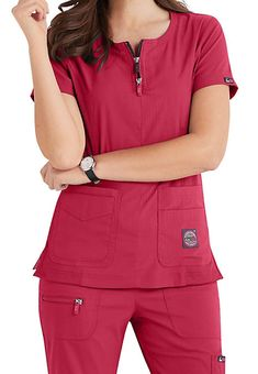 Koi Lite Serenity tops feature a double zipper neckline, ribbed contrast panels and four handy pockets. Shop Scrubs & Beyond to get this style. Cute Scrubs Uniform, Scrubs Outfit, Stylish Scrubs, Koi Scrubs, Medical Uniforms, Uniform Design, Medical Scrubs, Scrub Pants, Scrub Tops