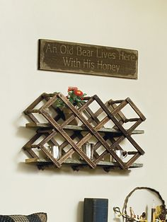 Repurpose an old wood wine rack as display space by outfitting it with planks cut to fit and used as shelves. To see more of this photo and find out more about the items shown, turn to page 114 of our September 2014 issue or page 37 of our online Craft Fair, http://www.countrysampler.com/craftfair/flipbook.php?issue_code=C0914