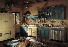 Marchi Group - Doria Cucina rustica in stile country in muratura - Stufa vintage e tavoli e sedie in legno