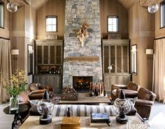 In the living room of a home in Lake Tahoe, California, designer Will Wick updates the traditional mountain retreat with dark stone floors contrasted with whitewashed cedar walls and pale curtains in Altizer & Co. linen. Leather club chairs, Restoration Hardware's Dutch Industrial coffee table, and blackened steel accents add earthy touches to the restrained palette.   - HouseBeautiful.com