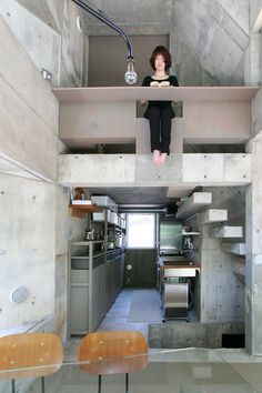 oriel window house by shinsuke fujii offers cherry blossom views in japan, yokohama-based architect shinsuke fujii has designed a concrete dwelling that offers panoramic views of the cherry blossom trees opposite. Architecture Du Japon, Interior Architecture, Interior Minimalista, Concrete Building, Micro House, Tiny House Living, Living Room, Japanese House, Tiny House Design