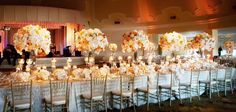 Florals are at bloom... fabulous wedding table top!!  Let orange & white work for your wedding.