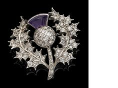 An gold amethyst and diamond thistle brooch, London 1976 Set throughout with round brilliant-cut diamonds, the flowerhead set with a cabochon-cut amethyst, width stamped 'WT & S' Antique Jewelry, Vintage Jewelry, Tartan, Motif Floral, Schmuck Design, Sea Glass Jewelry, High Jewelry, Diamond Cuts, Art Nouveau
