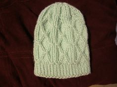 Ravelry: Diamond Trellis Baby Hat pattern by Heather Tucker
