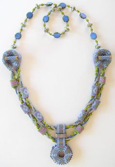 Aurora Necklace Beadwork Kit - Slate Blue - Aurora Necklace shown in Slate Blue, Olive, and Rose. The Aurora's three-dimensional peyote elements and three strands of twisted beads combine to make a modern statement with an Art Deco flair. The sample shown is 25 inches in length.