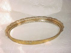 Vintage Hollywood Regency Footed Vanity Tray / Wall Mirror Gold-tone Ornate Oval ~ seller; florasgarden on ebay