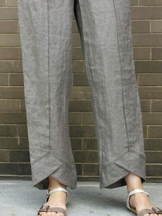 This basic pull-on pant from Spirithouse is anything but. It features a Flat front with elastic sides and back, as well as two hidden side pockets, which insure this to be the pant you reach for all summer long. The detail that sets this pant apart from all the others is the v-cut fold at the bottom front hem.