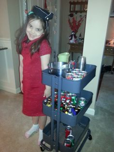 Our little flight attendant and her beverage cart. The cart can be purchased at IKEA.