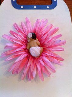 Fondant baby on pink flower cake topper