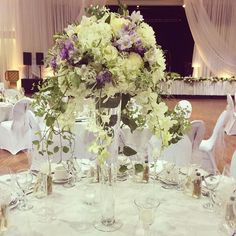 fabulous vancouver florist Tall #centrepiece from my #wedding last Saturday. #garden style with touches of #lavender coloured #freesia and #lisianthus #white #hydrangea #roses #stock #clematis #orchids #vancouver #vancouverweddings #fiorirevancouver #flowers #florist #floristlife #pretty  #vancouverflorist #vancouverwedding #vancouverflorist #vancouverwedding #vancouverweddingdosanddonts