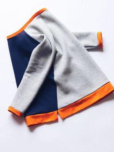 Classic cut sweatshirt for women with a contemporary twist. Made from organic cotton sweatshirt fleece. This sweatshirt features scoop collar, raglan