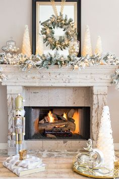 A Christmas wonderland family room with mixed metallics and flocked greenery!