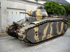 """B1 bis """"Flandres."""" Mounting a 75 mm howitzer in the hull and a 47 mm gun in the turret, the Char B1 acquitted itself well against German armor in the battle for France. France lacked the production capacity to produce them in large numbers."""