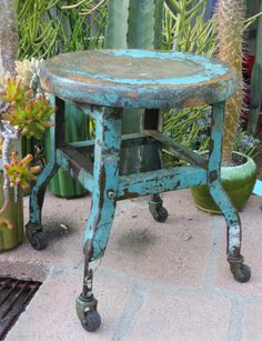 Coolest little stool I ever did see. Distressed Rustic Turquoise Steel & Wood Industrial Footstool: Rolling Aqua / Green / Blue Farmhouse Work Stool w/ Excellent Patina