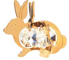 Bunny Twins 24k Gold Plated Ornament or Suncatcher Made With Swarovski Crystals  --  Is it an Ornament? Yes! Hang it on a hook where it will show its charm. Is it a Sun Catcher? Yes, when you pair it with a suction cup that you can attach to a mirror or window. This adorable little bunny is beautifully crafted with a 24k shiny gold plated finish and Swarovski crystals that create all the sparkle.