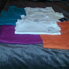 Bundle of 5  tank tops Green, pish pink, Orange,  and 2 white. Four have a design around the neck line. One white is plain. St. John's Bay Tops Tank Tops