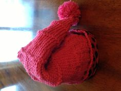Knitted child's hat with fleece inside.