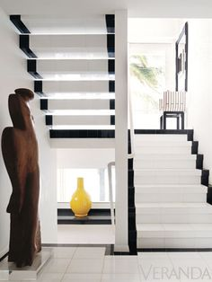 This black and white stairwell is one of the many striking spaces in the home of late designer Geoffrey Beene.