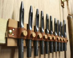 Leather Punches in a custom holder made from the scrap pile.