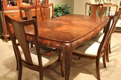 Love the design in the wood on this dining table - Colleen's Classic Consignment, Las Vegas.